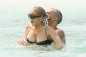 Lindsay Lohan Bikini Pics Complete with Nipple Slip from the Bahamas