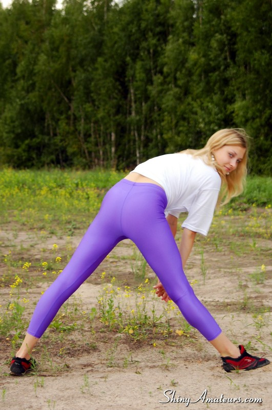 pretty jogger lady in purple yoga pants