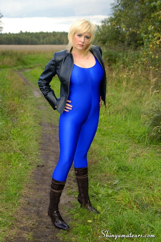 blonde babe in sexy leather boots & blue unitards