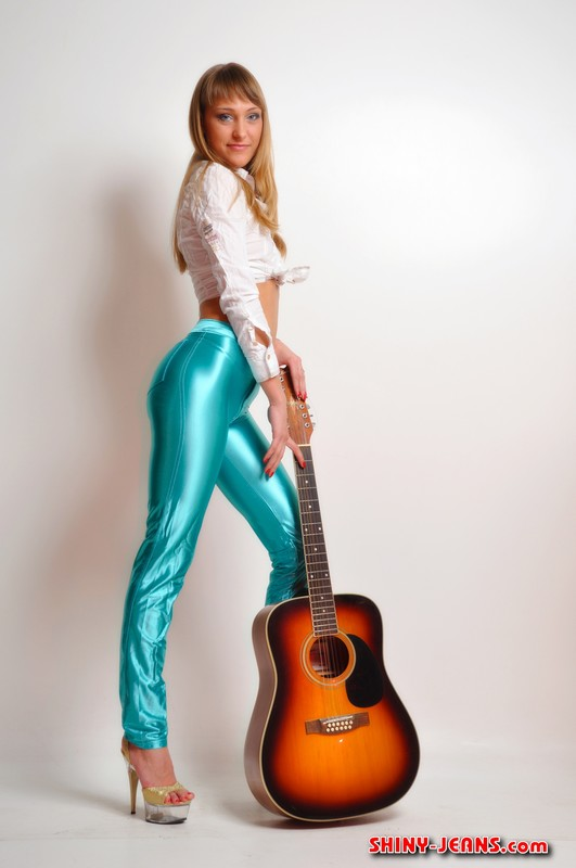guitar girl Maria B in green sexy shiny jeans
