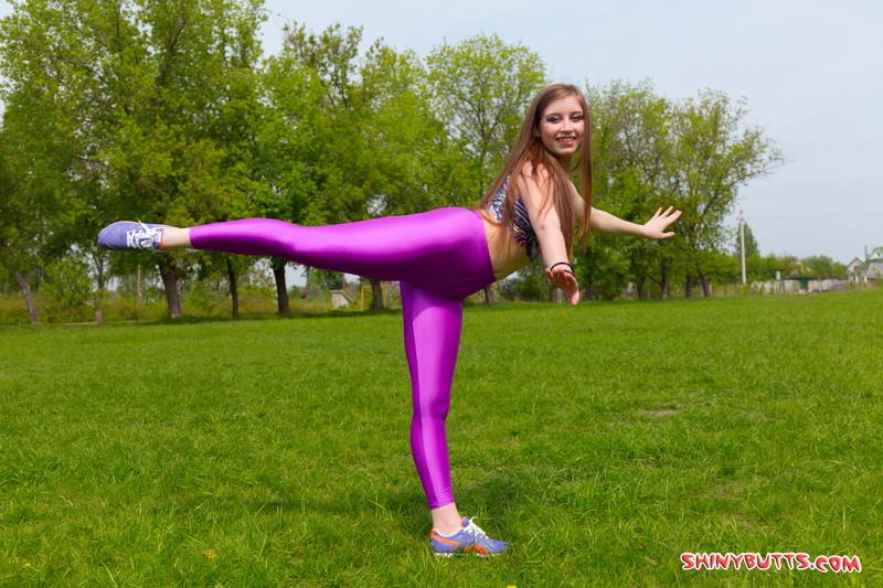 handsome gymnast teen Valya in purple yoga pants