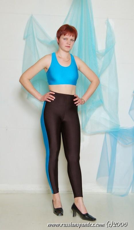 short hair lady in skin tight gym uniform & high heels