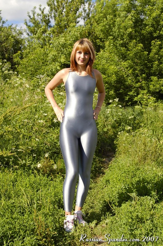forest hiker girl in sexy grey jumpsuit