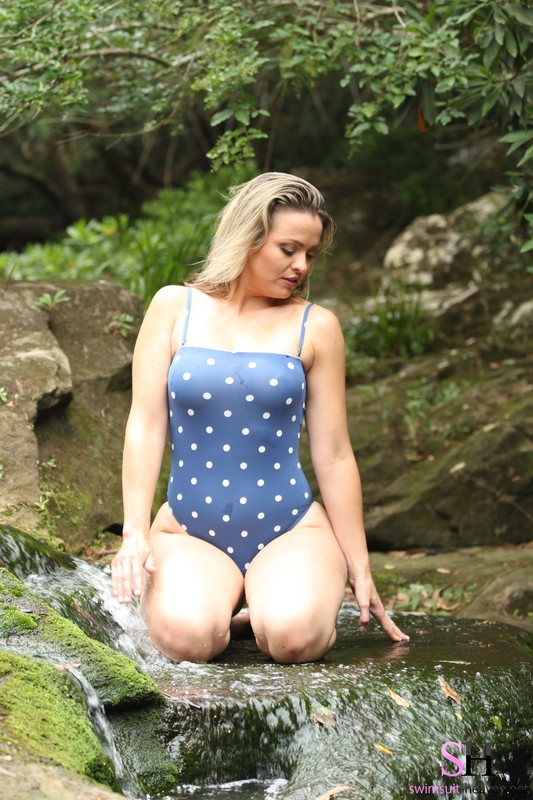 forest hiker chick Alexis in polka dot swimsuit