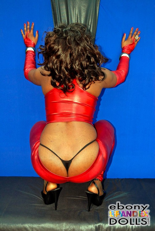african chick Lola in red shiny leggings