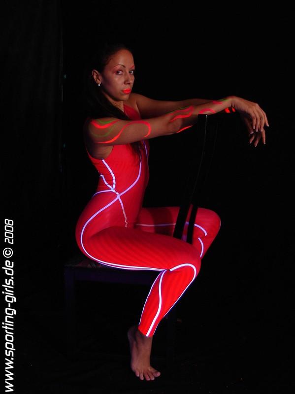 charming female Melli in skin tight speedo diving suit