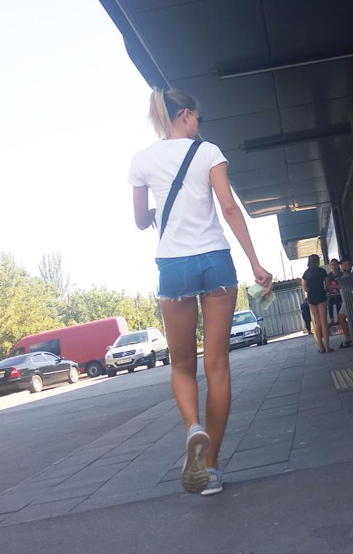 leggy college teen in denim shorts
