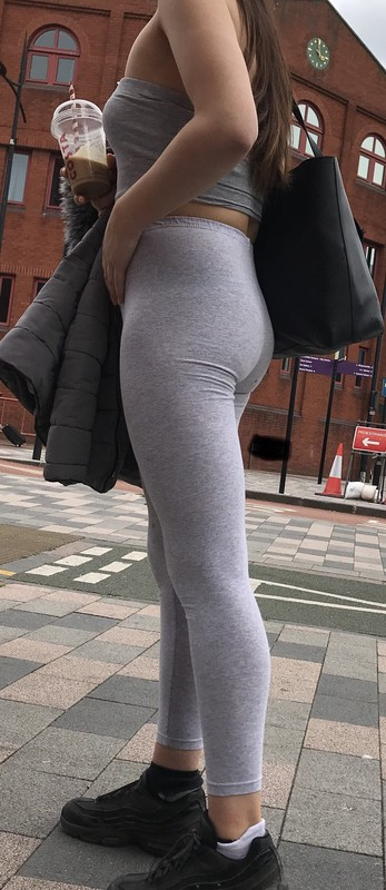 hansome lady in grey spandex pants