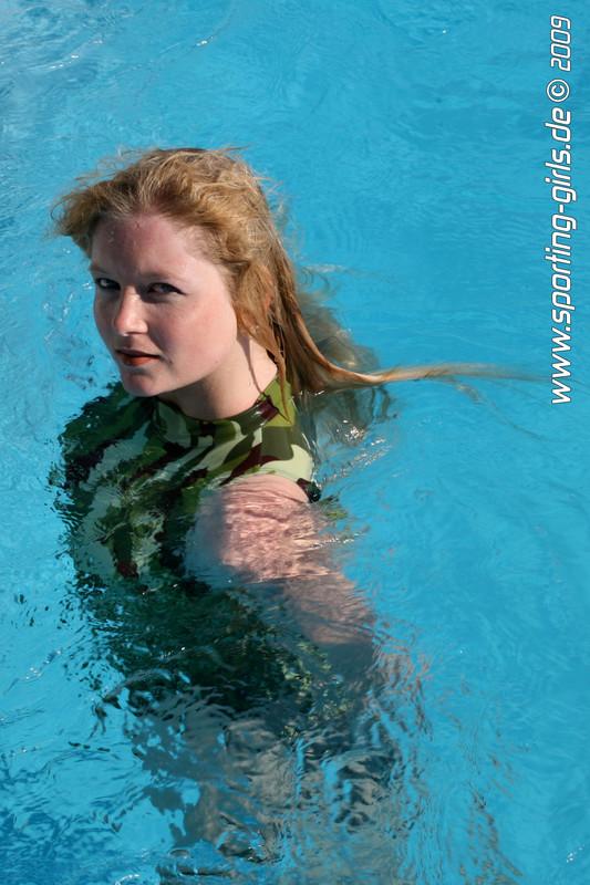 pool girl Saskia in camouflage swimsuit