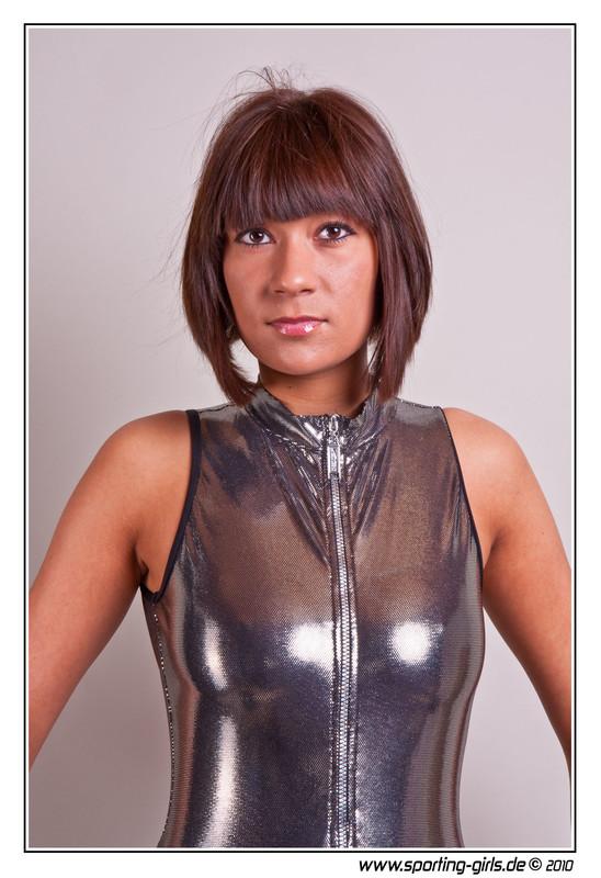 naughty lady Jacky in wetlook silver swimsuit