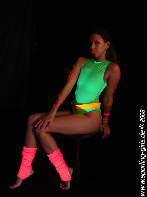 stylish babe Melli in green speedo swimsuit