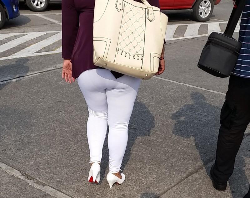 attractive milf in white leggings