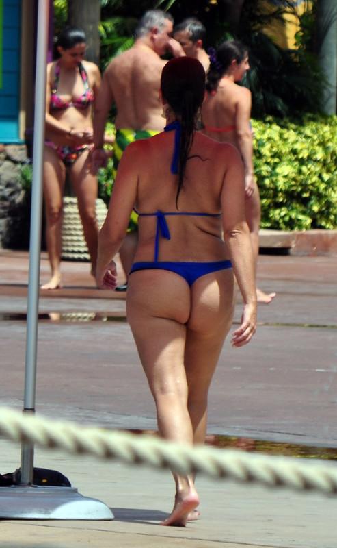 curvy waterpark milf in blue bikini