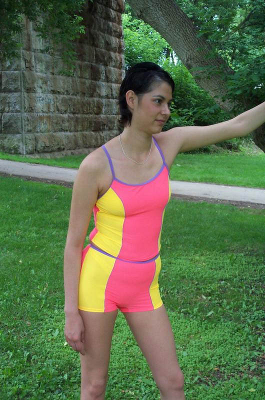 brunette shorthair lady in kinky fitness uniform