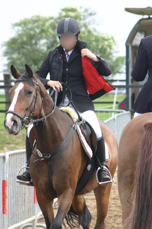 horse riding competition girls in candid uniform