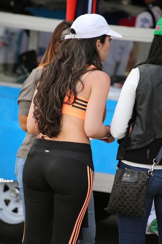 sporty hispanic chick in adidas leggings