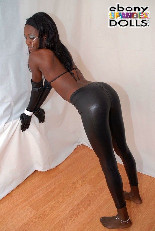 african model Tania in kinky leather leggings