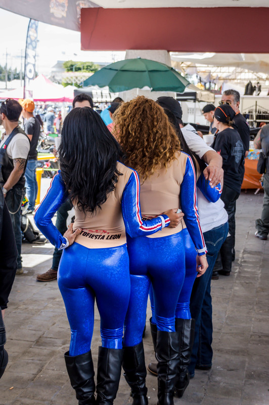 promo girls in blue shiny catsuits