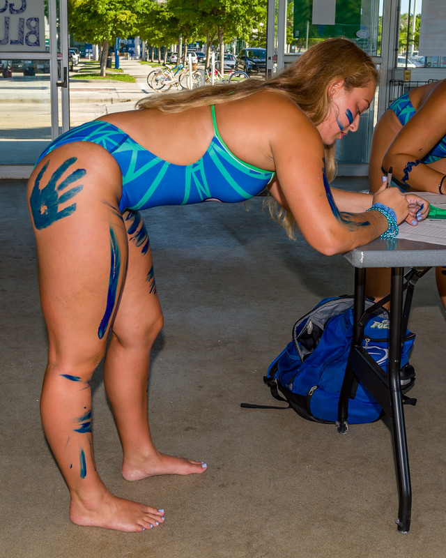 college athletic team in swimsuits