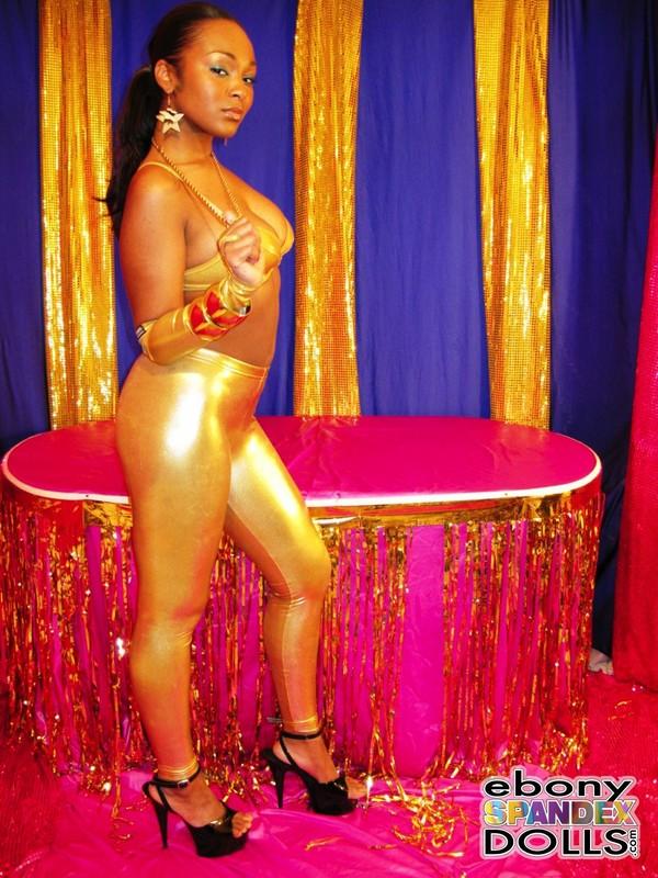 hot ebony woman Yasmin in golden leggings