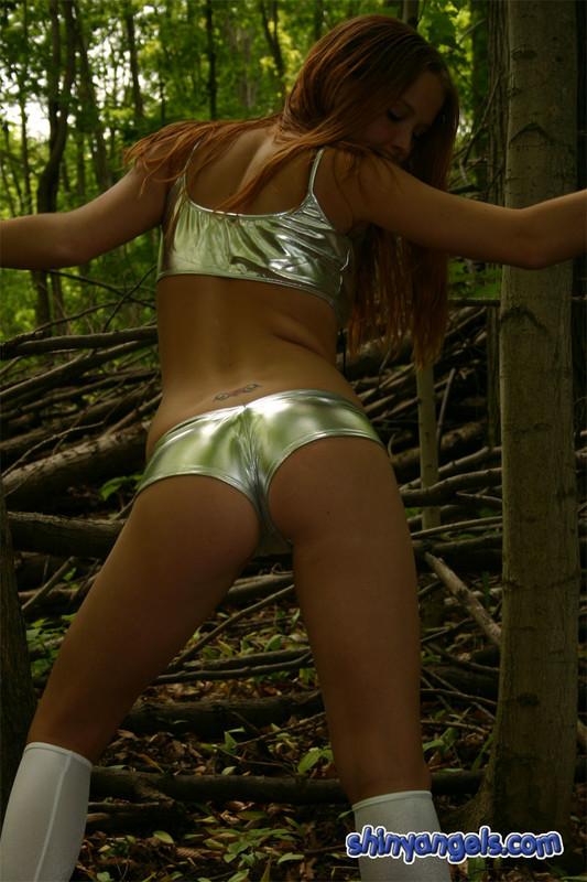 handsome shiny angel teen in silver bikini