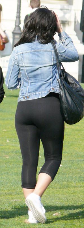 brunette lady in tight black lycra pants