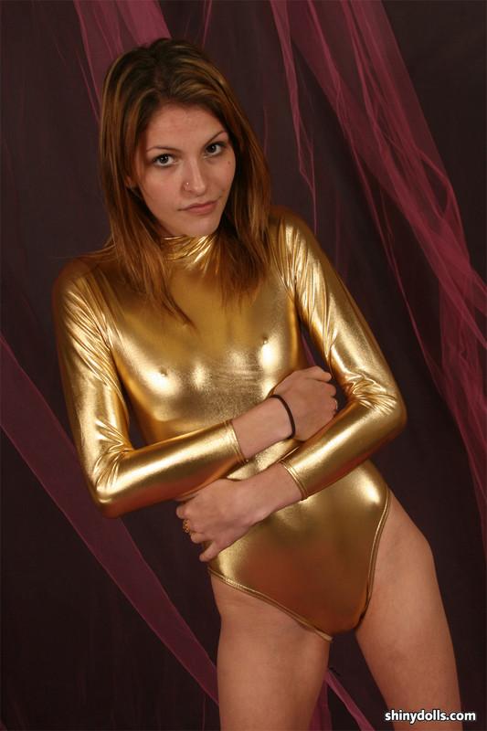 shiny doll Lola in sexy golden metallic leotards