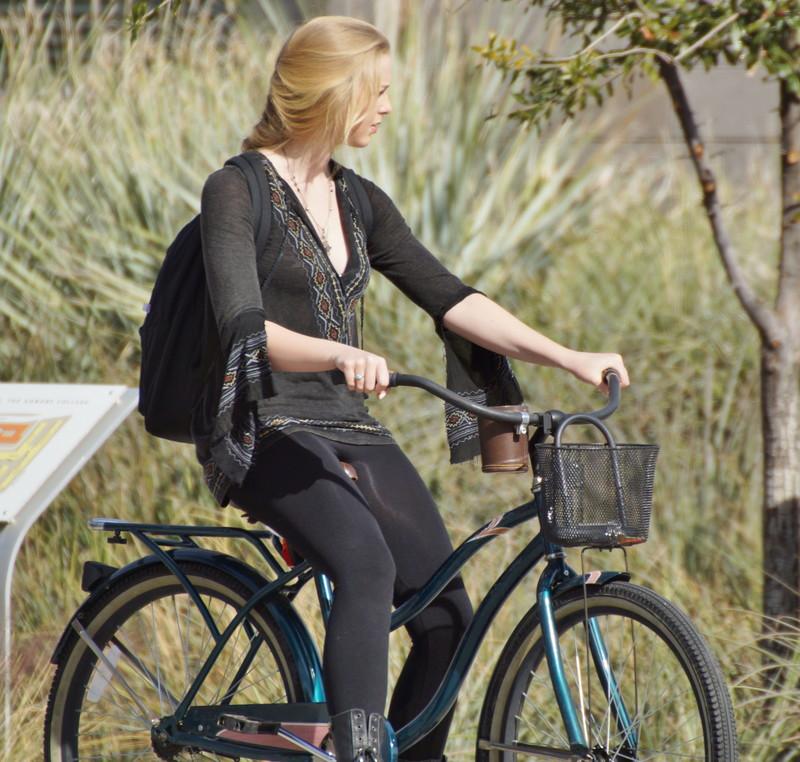 blonde cyclist teen in black lycra pants