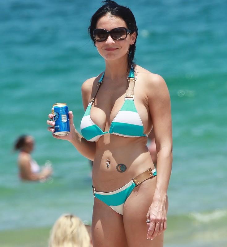 busty brunette lady in sexy green & white bikini
