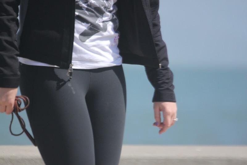 dogwalker lady in black yoga pants
