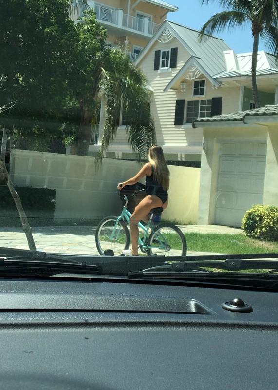 bikini girl riding a bicycle