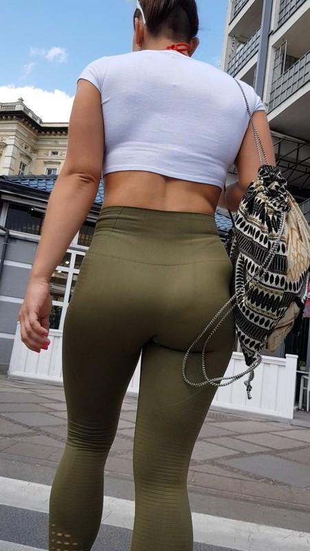 insanely hot milf in tight green leggings & heels