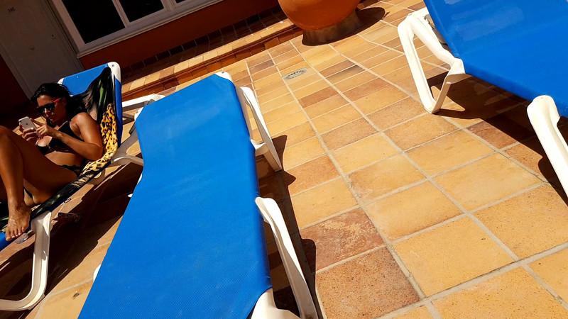 hotel pool lady in black bikini