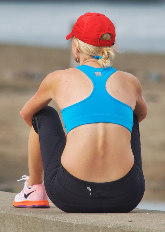 blonde jogger milf in blue sports bra & black leggings