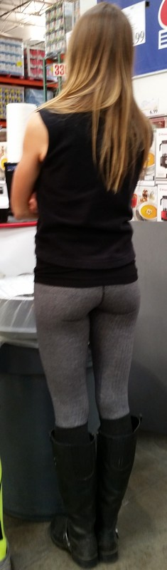 milf in grey leggings at store