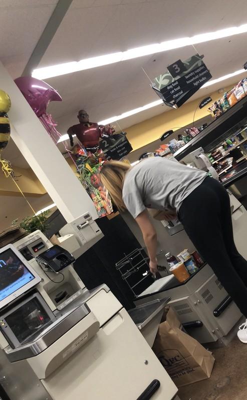 shopper teen bending over in black leggings