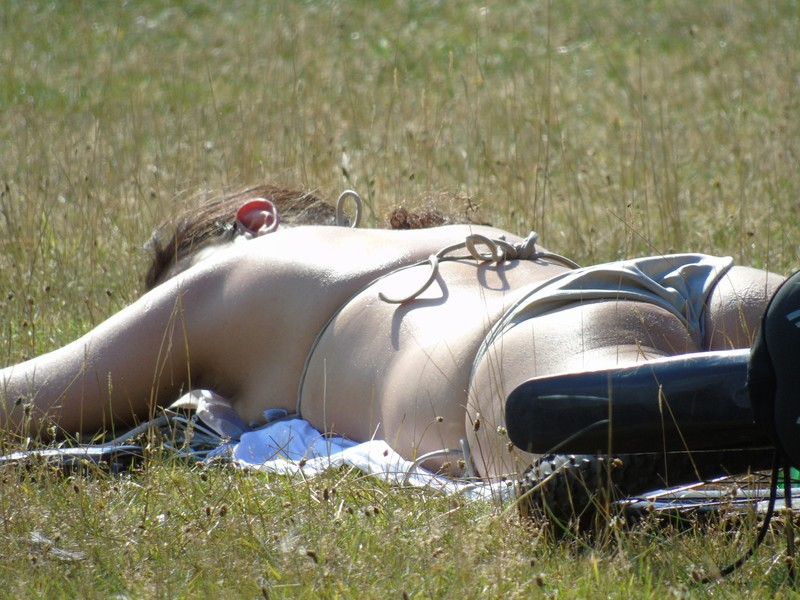 sexy cyclist milf sunbathing in the national park