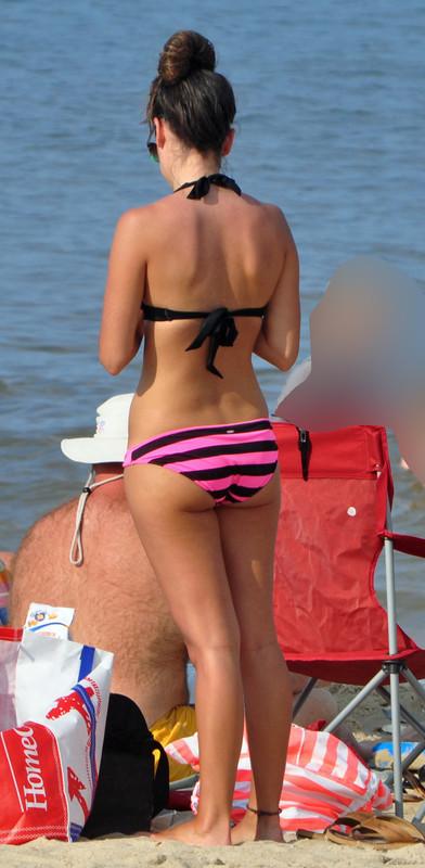 skinny brunette lady in sexy bathing suit