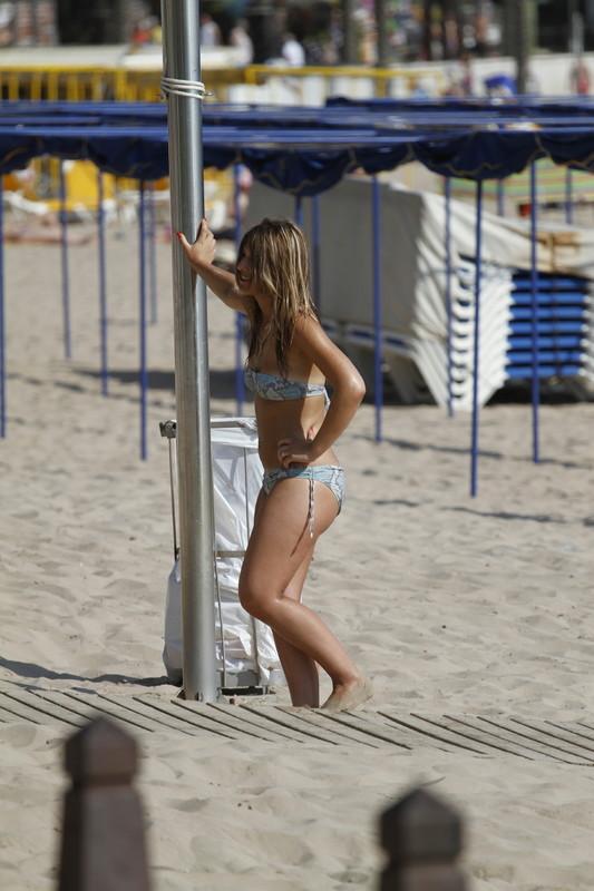beautiful girl sun tanning in bikini