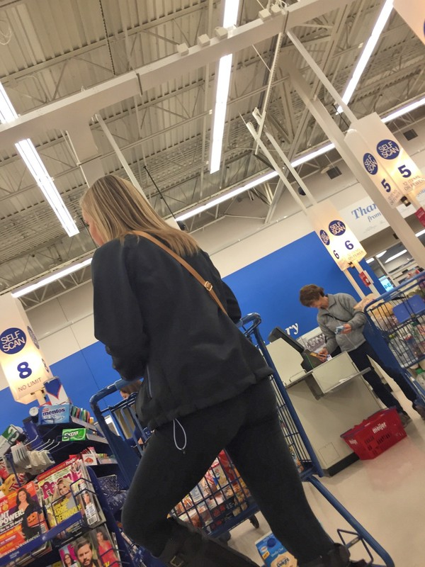 supermarket lady in tight black pants & boots