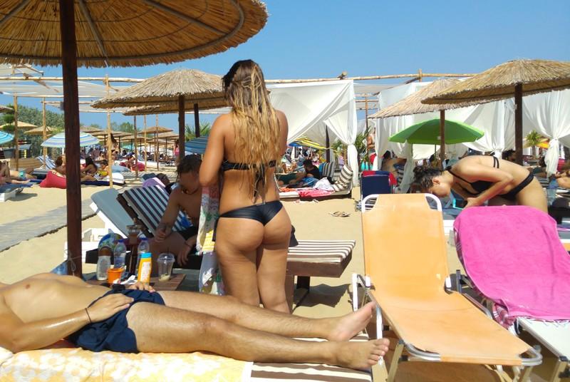 sweet tanned babe in black bikini
