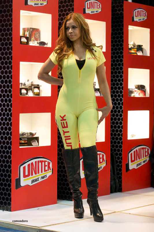 beautiful promo girl in tight bodysuit & leather boots
