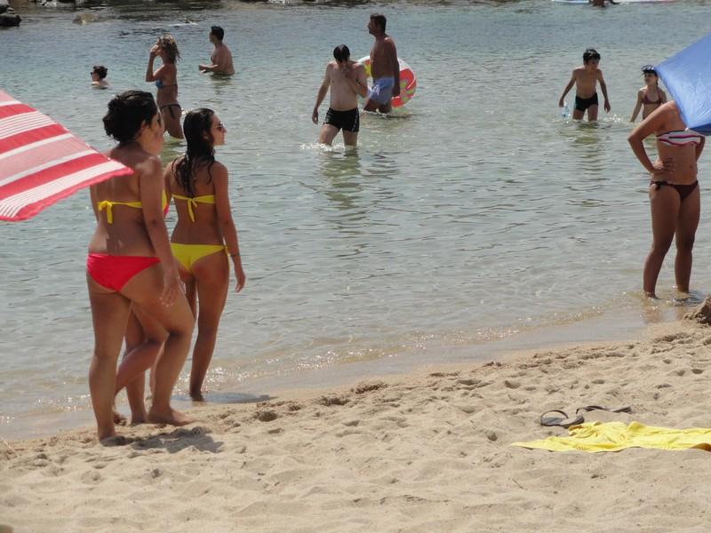 3 hot girls walking on the beach