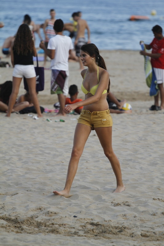 beach volleyball teen in bikini top & shorts