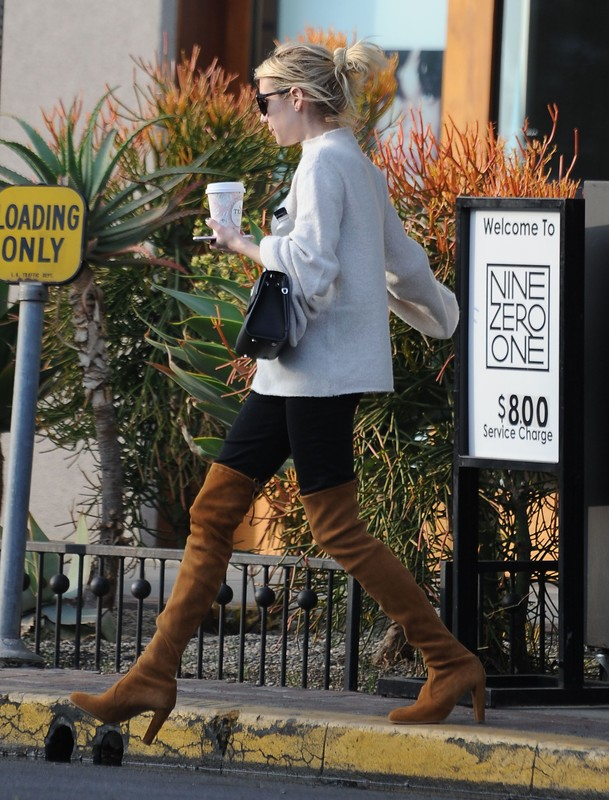 stylish babe Emma Roberts in black leggings & knee high suede boots