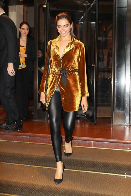 indian actress milf Deepika Padukone in shiny black leggings