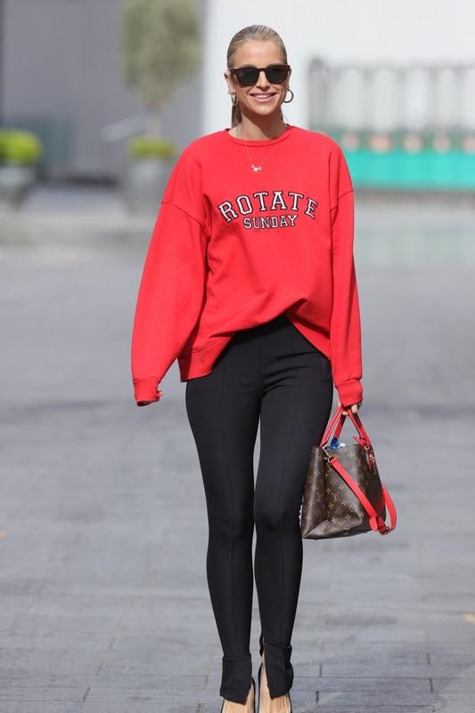 blonde hottie Vogue Williams in black leggings and red top