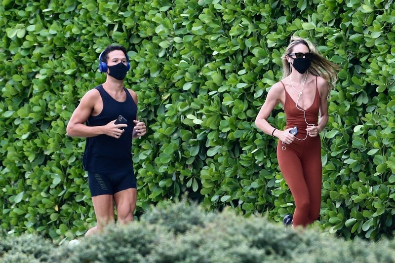 jogger babe Candice Swanepoel in candid outfit