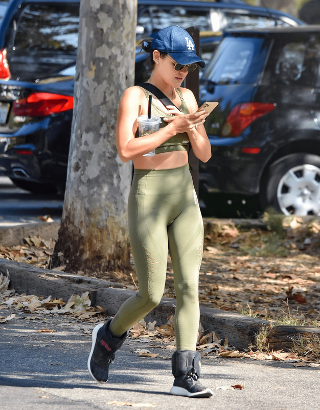 pretty babe Lucy Hale in green fitness uniform