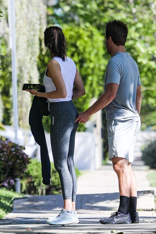 lovely babe Nina Dobrev in grey yogapants